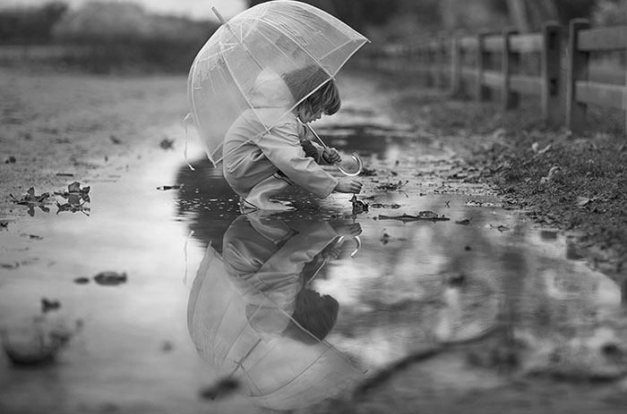 Child in Rain Black and White