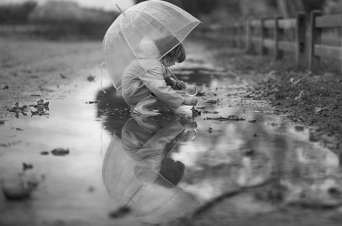 Child in Rain Black and White